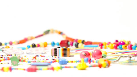 Colorful Plastic Jewellery 02 dolly left Stock Video Footage