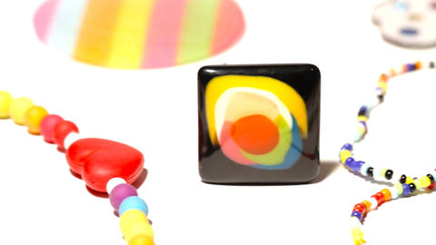Colorful Plastic Jewellery 04 dolly right Stock Video Footage