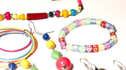Colorful Plastic Jewellery 06 pan left Stock Video Footage