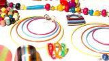 Colorful Plastic Jewellery 06 Pan Left stock footage
