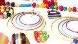 Colorful Plastic Jewellery 06 Pan Left stock footage