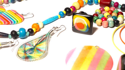 Colorful Plastic Jewellery 06 pan left Stock Video Footage