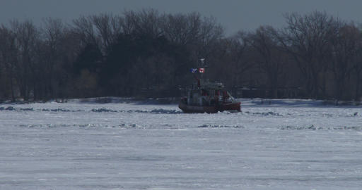 Fire rescue boat navigating on frozen lake Ontario Footage