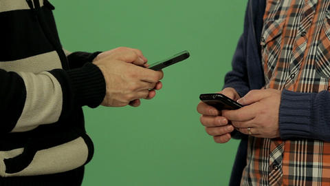 Two Men Using Smartphone stock footage