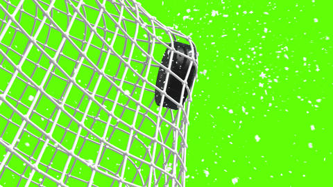 The Puck Flies To Gate On Green Background stock footage