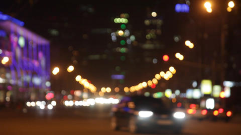 Out of focus city traffic at night. Car headlights and tail lights out of focus Footage