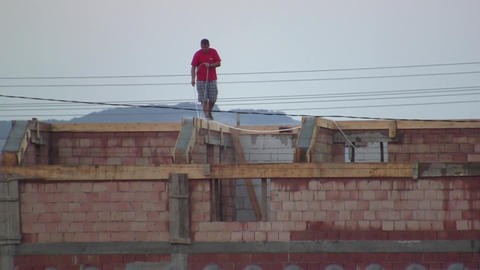 Worker who wet concrete of a house under construction 02 Footage