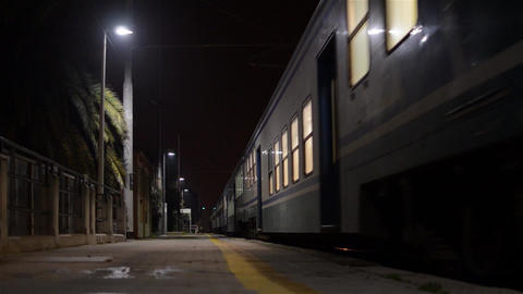 Passenger Train Leaving At Nigth 2748c stock footage