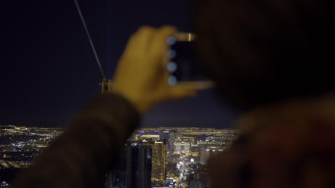 Taking picture of Las Vegas Strip from tower 4K UHD Live Action