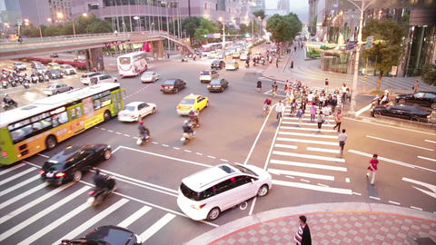 Rush hour traffic at intersection in Xinyi Financial district in Taipei Live Action