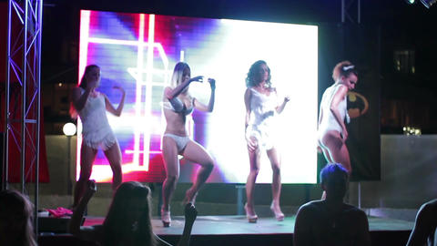 4 hot and sexy PJ dancers on the stage of summer nightclub Footage