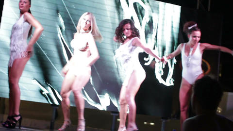 4 hot and sexy strip dancers on the stage of summer nightclub Footage