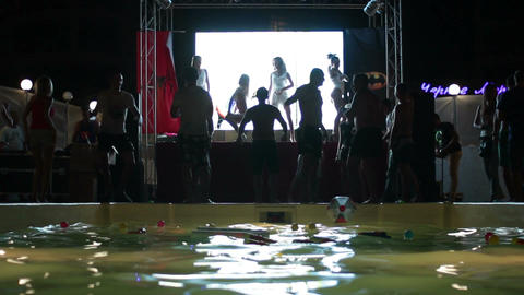Summer party: young people dancing near the pool Footage