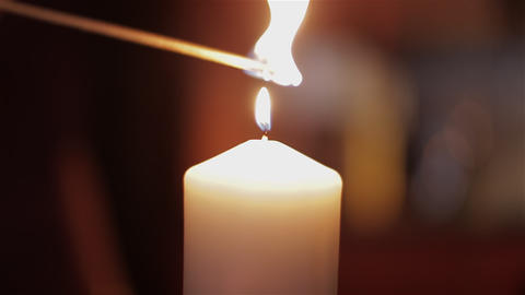 Lighting A Candle With A Match stock footage