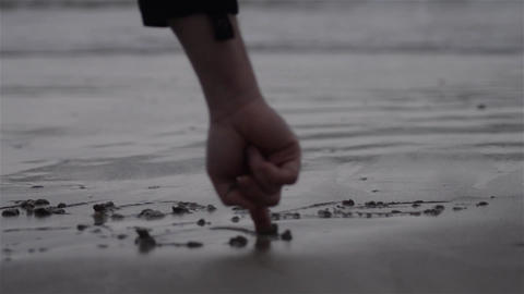 The hand that writes the sand 01 Footage