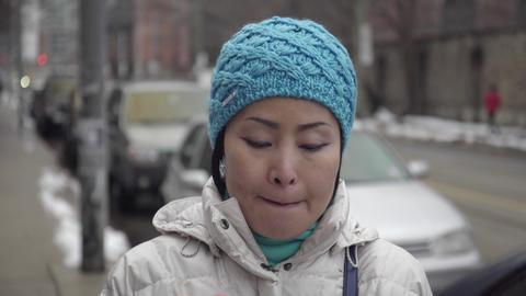 Asian Woman Putting On Lipstick stock footage
