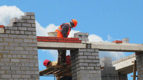 Worker Builds A Wall Of Bricks Footage