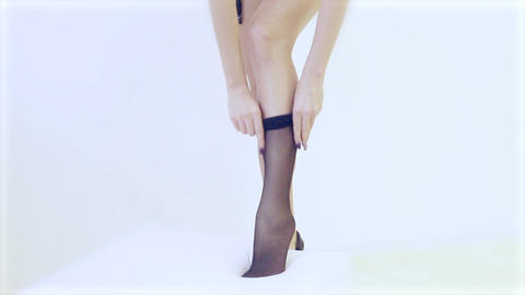 sexy girl wears stockings on a white background, full length Footage