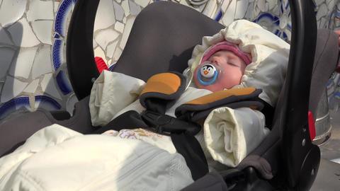 Little Sleeping Newborn Baby Swing in Safety Car Seat. 4k Ultra HD Footage