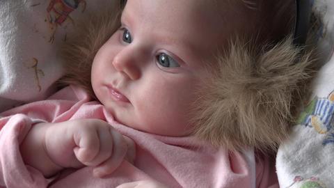Newborn Baby with Fur Headphones. 4k Ultra HD Footage