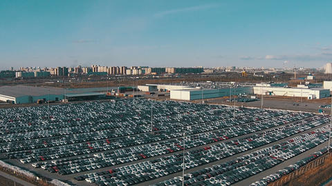 Flying Above Storage Parking Lot of New Unsold Cars Live Action