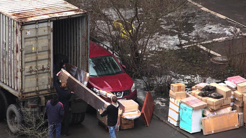 Workers Unload Items From The Van. 4K stock footage