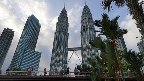 KUALA LUMPUR - February 2015: Petronas Twin Towers with palm trees, Kuala Lumpur Footage