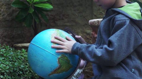 Child playing with the Globus Stock Video Footage