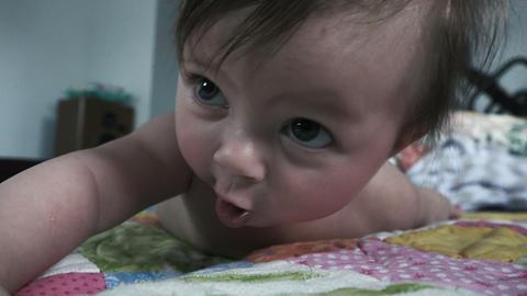 Baby Turning Towards Camera on Tummy Footage