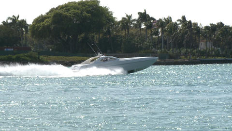Speedboat Cruising Down A Canal stock footage