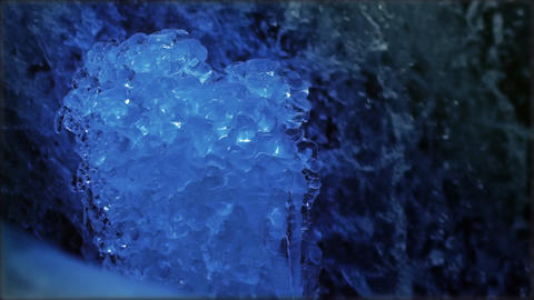 View Of Frozen Snow On Water Flowing, Crystal Icicle On A Mountain Creek In Sunl stock footage