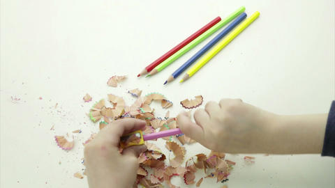 Hands sharpening a colorful pencil crayon Footage