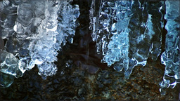 View of Frozen Snow on Water Flowing, Crystal Icicle on a Mountain Creek in Sunl Footage