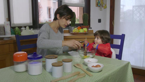Lifestyle Baby And Woman Cooking Together In Home Kitchen Footage