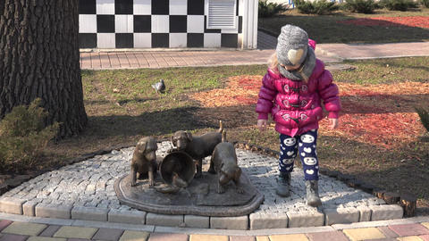 Adorable Cute Young Girl with Decorative Puppies in Park. 4K UltraHD, UHD Footage