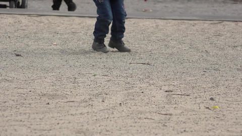 Close up Little Girl Running in Boots on Sand. 4K UltraHD, UHD Footage