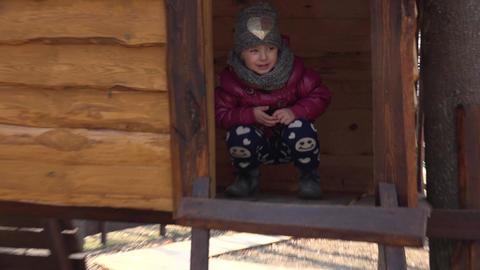 Little Girl in Wooden Playhouse. 4K UltraHD, UHD Footage