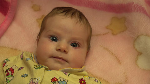 Portrait of a Surprised Baby Girl. 4K UltraHD, UHD Footage
