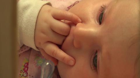 Baby Sucking Her Fingers, Closeup. 4K UltraHD, UHD Footage