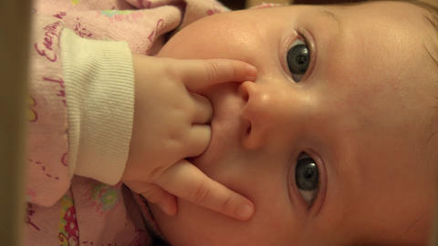 Baby Sucking Her Fingers, Closeup. 4K UltraHD, UHD Footage