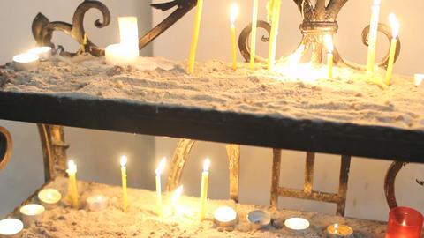 Candles burning in Catholic Church on Easter Sunday Footage