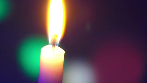 Candle On A Colored Background Moving stock footage