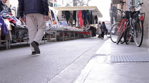Pedestrian traffic in the clothing market 3 Stock Video Footage