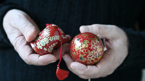 man with painted Christmas ornaments Stock Video Footage