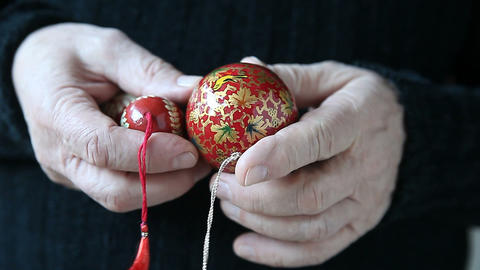 man with painted Christmas ornaments Footage