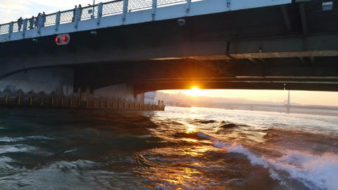 Bosphorus sightseeing ship leaving from Galata Bridge on sunset Footage