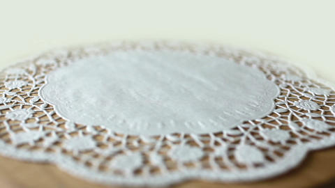 flower on lace doily Stock Video Footage