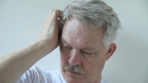man scratching his scalp Stock Video Footage