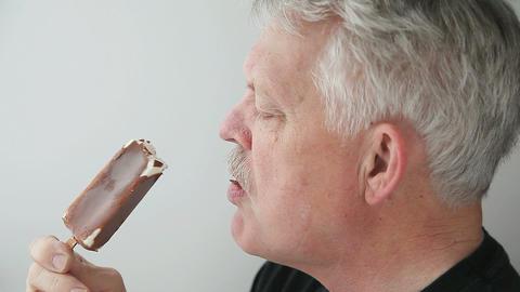 man eating ice cream bar Stock Video Footage
