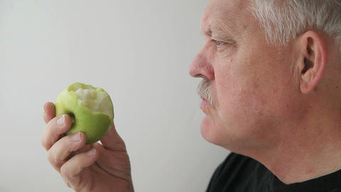 man eats green apple Footage